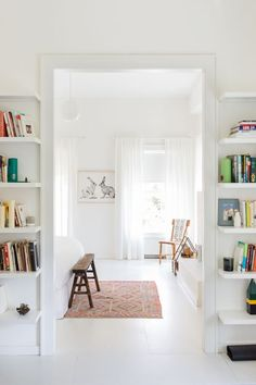 bookshelves in an entryway