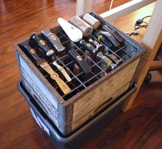 Hammer box. This idea would work with pliers as well, and other tools... a grid secured across a container.  I like this idea.