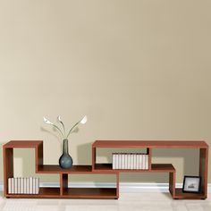 """Jesper Expando Puzzle Bookcase  www.hayneedle.com.  Hayneedle offers free shipping.  This is two """"L"""" shaped shelving units, at about $400 each."""