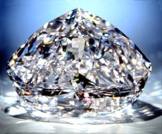The Centenary diamond is said to be the largest, faceted, D-color, flawless diamond in the world      273.85-carat      Type IIa       D-color diamond      Modified heart-shape     Internally flawless IF     50.50 x 39.90 x 24.55 mm.     247 facets, 164 on the crown and the pavilion, and 83 around the girdle.