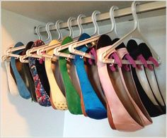 Attach clothespins to hangers.