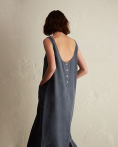 Easy sun dress in a lightweight, supple linen. Low scoop neck and back with button opening below. Two patch pockets.