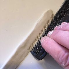 using comb to make spiky sections on the clay