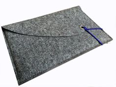 The tailor-made, casual and functional natural grey felt sleeve present a timeless, Scandinavian, cosy design.  The laptop soft cover is carefully made by hand, with love to details, in several production steps in a little studio in Bavaria Germany, out of 0,08 ins thick, eco-friendly 100% wool felt.  Besides the main pocket for you MacBook the case consist of an additional large front pocket inside the flap, which is meant for documents ect.. The two layers of felt (0.16 ins) gives your…