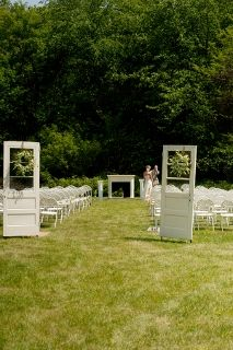 styled doors at outdoor wedding mark seating area