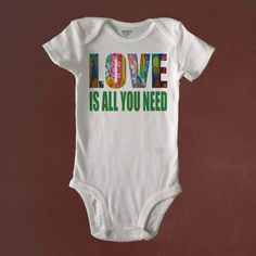 Love is All You Need, Baby Bodysuit Custom Made to Order using Carter's brand bodysuits.  Love is made out of surfboards in the background.  Visit us also at RetroBabyWear.com.