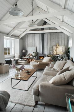 Exposed beams and vaulted ceilings, love this picture - cosy & modern at once