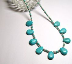 Gorgeous necklace made with turquoise blue color howlite teardrops, tiny howlite and silver color glass beads. Measures 25 inches. Silver plated lobster claw clasp. Shipping is Free. I only ship within the U.S.A. $40.00