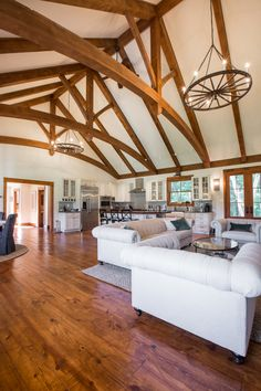 Modern kitchen pair with timber frame trusses in the great room Timber Frame Home Plans, Timber Frame Homes, Post And Beam, Mountain Homes, Great Rooms, Modern, House Plans, Construction, Flooring