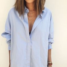 blue shirt / simple jewelry