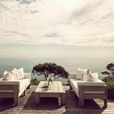 This outdoor seating area is magical, look at that view!