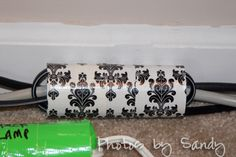 Organize cables and cords with duct tape and toilet paper rolls