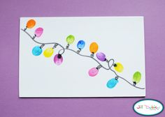 thumbprint christmas light cards...so cute!  would be easy for the kids to make...