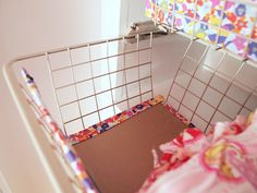 Use fabric-covered cardboard to create a false front for mesh baskets and hide clothes clutter