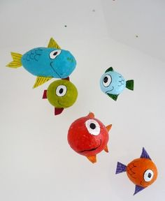 Paper machae fish from balloons--could throw in a purple mermaid or two?
