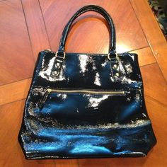 J crew black patent leather purse In amazing condition, no scratches or stains and handles are in perfect condition! Has a zipper pocket perfect iPad etc! Also has a couple inside picked for phone and wallet and one zipper pocket on outside! J. Crew Bags