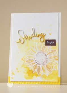 handmade greeting card from rieslingmama . sunflower line art embossed in white over smooshed and splatted yellow Distress Ink .