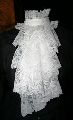 """Jabot - Price: $35.95  Wear this feminine lacy jabot made of cascading rows of ruffled lace over any blouse, jacket,or dress to make the outfit instantly """"Victorian"""". Back neck closure."""