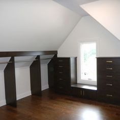 Slanted Ceiling Storage & Closets Design Ideas, Pictures, Remodel and Decor Long hang ups in the middle and shoe storage on opposite end Attic Master Bedroom, Upstairs Bedroom, Attic Rooms, Attic Spaces, Attic Apartment, Apartment Therapy, Ceiling Storage, Attic Storage, Closet Storage