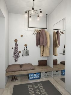 Small Apartment Under 30 Square Metre – One Light. The gorgeous entryway hosts every feature necessary to welcome guests comfortably, including a sitting bench with space for shoes and storage beneath, and cute round-peg coat hangers.