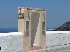 What's wrong with this picture? This is the front door to a restaurant in Santorini. But where is the restaurant? Because the towns on Santorini are often built on cliffs this door leads to stairs down to the restaurant.This is a surprisingly common sight on the island as the picture below will attest to.