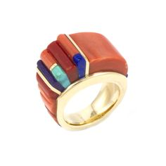A beautiful 14k gold ring with height inlay of Mediterranean coral, sugilite, lapis, and turquoise by Charles Loloma. Size 7 1/4. 1/2″ at widest point.