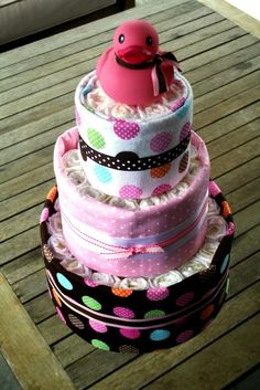 How cute!!! Boutique Style Diaper Cake with Scarf Clad Rubber Ducky- Girl- 3 Tiers. $65.00, via Etsy.