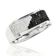 This Mens Black and White Diamond Pinky Ring in Sterling Silver showcases 0.30 carats of round diamonds and a luxurious rhodium plating for extra shine. This men's silver diamond ring is an affordable alternative to expensive gold jewelry.