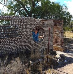 House made from tin cans near the first opal mine found at Lightning Ridge. Renate at the window