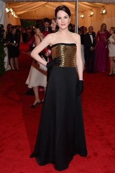 Michelle Dockery in Ralph Lauren at the 2012 Met Gala. Longer gloves, some necklaces, maybe a bit more beading and it's almost Downton-appropriate. Simple, but pretty.