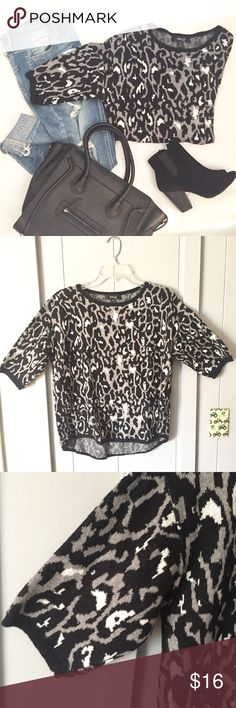 "Leopard Print Sweater in Black & Gray This sweater is perfect with your favorite jeans & bag! So soft. Cute slightly relaxed styling with 3/4 sleeves. White/gray/black animal print.   Medium Petite: ▪️22"" armpit to armpit flat across and 23/26"" shoulder to hem length (hi-lo.) ▪️60/20/20 cotton nylon rayon. In great condition! Style & Co Sweaters"