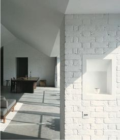bagged brick in contrast to smooth white walls