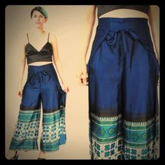 Handmade navy wide leg pants Handmade, wide leg open on the sides, in navy. Adjustable fit, fits women's size 0-8. Two ties at waist for closure, front panel first ties around waist, ties in back. Back panel ties around waist and ties in front.. This leaves legs open on outside sides. A little dressy, a little sexy, a little hippie style.. Depends on what you match then with. Have only been worn a couple of times (I just outgrew them). From SF/PF home and in EUC. (1st pic is only to better…