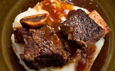 This recipe uses a pressure cooker and cola to make tender spice-rubbed short ribs served with a savory sauce in minutes rather than hours.