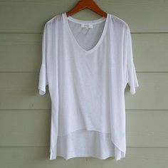 ✨HP✨ UMGEE sheer hi lo top NWOT Sheer white v neck top. Super cute, flowy and breezy, perfect for summer!  Features raw edge hi lo hem at bottom and fitted drop sleeves. Can be dressed up or down easily. Never been worn but tags are not attached. 60% polyester 40% cotton umgee Tops