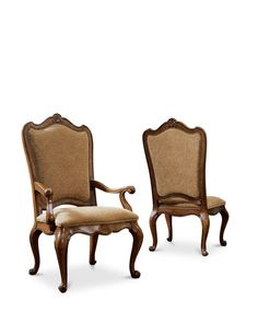 Villa Cortina is an Old World traditional design.  The side chair is fully upholstered in a luxurious fabric with brass nailhead trim.  The wood has wonderful detailing and a warm cherry finish.