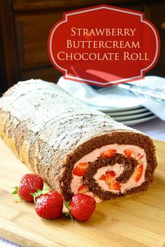 Strawberry Buttercream Chocolate Roll - This very summery looking chocolate roll cake is filled with very easy to make strawberry frosting and chunks of fresh strawberries. No artificial coloring.