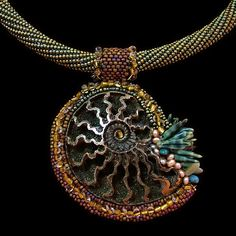"""Transmutations: Pyritized ammonite, fresh water pearls, art glass beads, and seed beads. Pendant - 3"""" wide x 3-1/2"""" high wi..."""