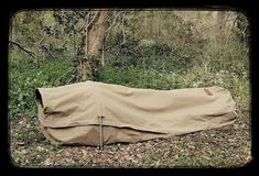 The new Wynnchester canvas bedroll - this looks amazing! I love that it can be setup as a hammock too. Bushcraft Gear, Bushcraft Camping, Camping And Hiking, Camping Survival, Hiking Gear, Survival Prepping, Hiking Backpack, Tent Camping, Camping Gear