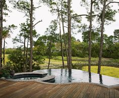 Make your deck feel more upscale by adding a pool or hot tub. Bump up the drama by adding a vertical-edge pool, such as the one shown here, where it looks like it drops off into space.