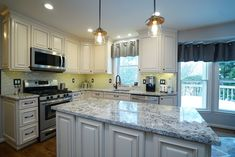 Fabuwood cabinetry, White subway backsplash