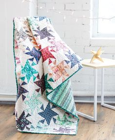 Twinkling Stars looks complicated, but it's really just one simple unit repeated eight times to create bright colored pinwheel star blocks. Click to check out the free video tutorial on how to make this quilt.