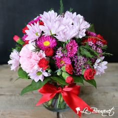 This delightfuly cheery arrangement features a variety of rosie toned carnations, daisies, caspia and matsumoto asters. Wow Wee, Carnations, Daisy, Centerpieces, Floral Wreath, Events, Red, Floral Crown, Margarita Flower