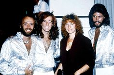 Barbra Streisand photographed with the Bee Gees in 1979.