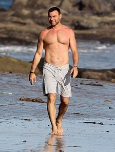 Couple Naomi Watts and Liev Schreiber enjoying a day on the beach with their…