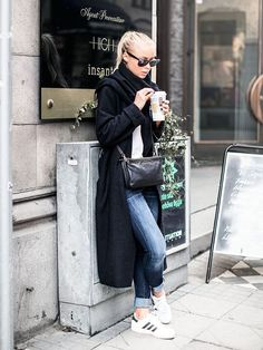 Classic coat, coffee and sneakers,