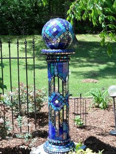Garden mosaic in Florence, Alabama. Its two pieces . Mirror and stained glass - used a clear drying waterproof glue. After grouted sealed with outdoor tile sealer. Mosaic Garden Art, Glass Garden Art, Mosaic Art, Mosaic Glass, Mosaic Tiles, Stained Glass, Glass Art, Pebble Mosaic, Mosaic Birdbath