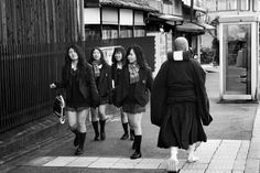 JAPAN. Kyoto. MYOSHIN-JI Buddhist temple complex of the Rinzai order of Zen. A monk and high school girls in uniform. By Abbas Attar