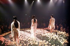 Lancome Colour Design Awards.  Designers love to put flower bouquets on tables, but they never leave them on the ground.  This is such an incredible catwalk!  Careful not to step on the flowers!  #Event #Design