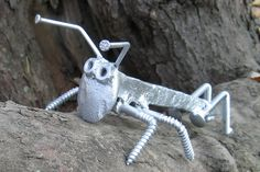 Welded Grass hopper from rail road spike and nails